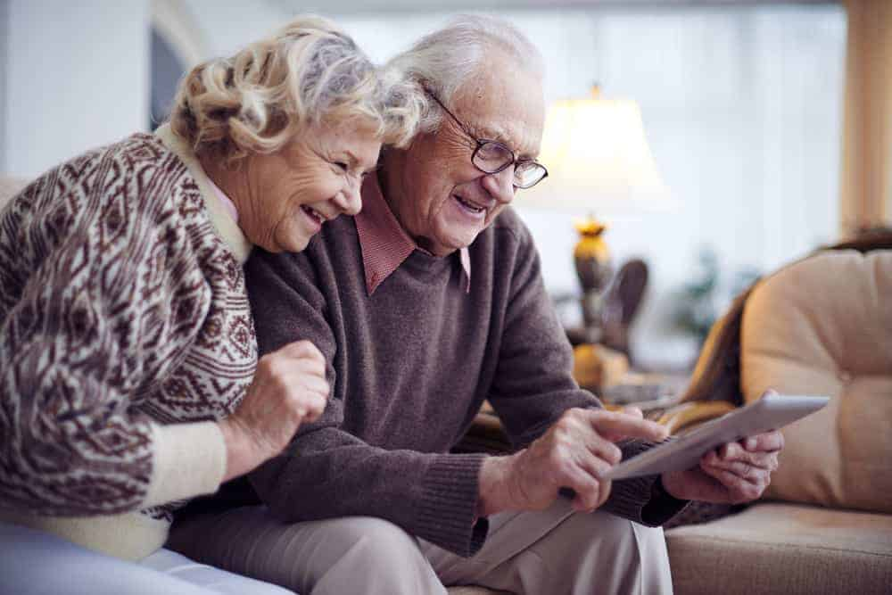 Elderly couple using tablet